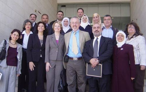 Prof. Richard Larson and Elizabeth Murray pose with BLOSSOMS teachers from the University of Jordan and 4 Jordan high schools.