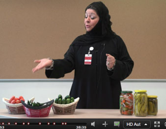 Instructor pointing to pickle jars